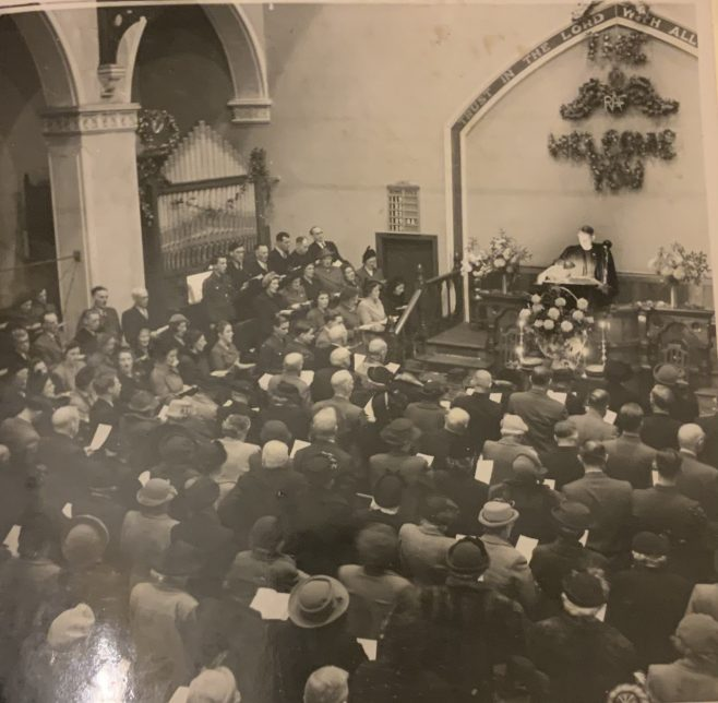 It is very unusual to show a congregation during World War 2 welcoming members of the RAF at Christmas