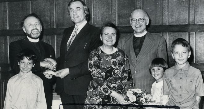 Presentation to Rev Eddie Smith, 1978. Also shown is Mrs Marina Smith who together with their sons James and Stephen, founded the National Holocaust Centre and Museum in Laxton, Notts. The gentleman making the presentation is Mr Douglas Anthony, church organist.