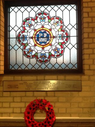 1867 window and WWI memorial   click to enlarge