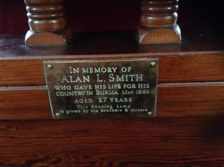 This brass memorial plate is placed on the pulpit | click to enlarge