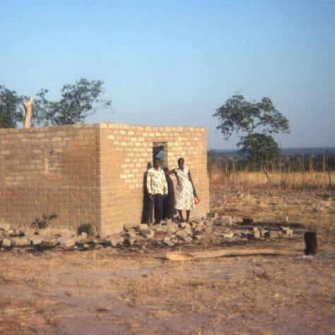Village Church under construction with Church Steward and Deaconess